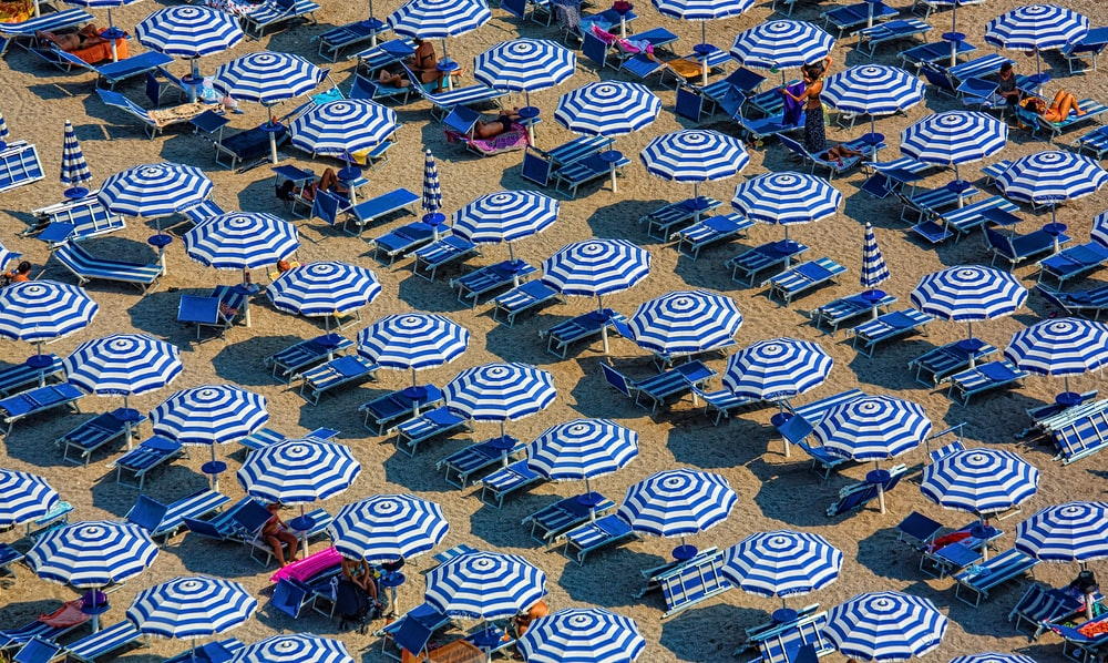 aerial photography of blue-and-white patio umbrellas